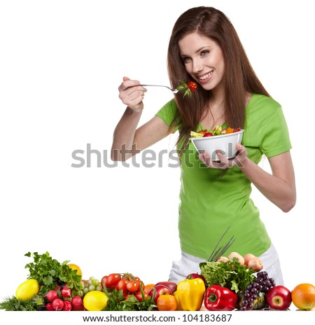 Woman with salad isolated on white - stock photo