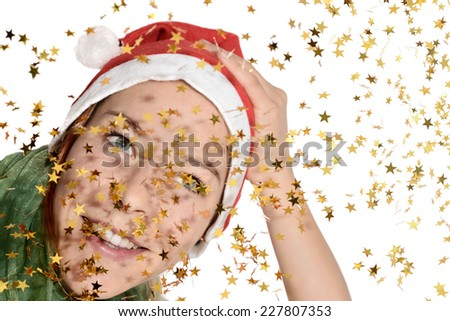 Woman with santa hat and festive gold stars - stock photo