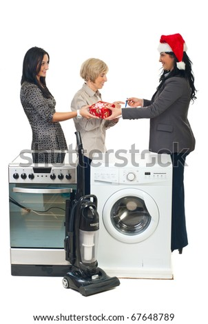 Woman with Santa hat make a special delivery to a family with household appliances - stock photo