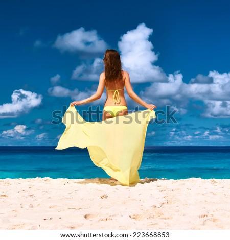 Woman with sarong at Seychelles beach - stock photo