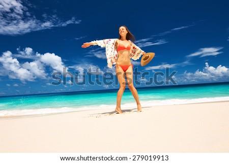 Woman with sarong on beach Anse Intendance at Seychelles, Mahe - stock photo