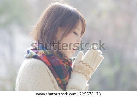 Woman with scarf and glove - stock photo