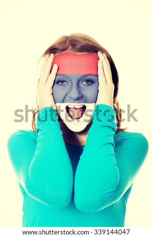 Woman with Serbia flag painted on face. - stock photo