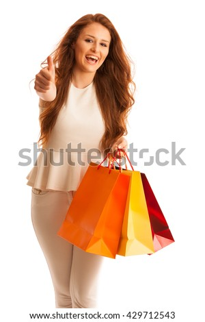 Woman with shopping bags after a successful purchase on the sale isolated over white - stock photo