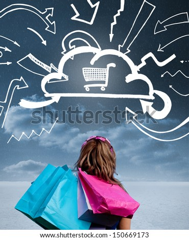 Woman with shopping bags and looking at a drawing with shopping cart into a cloud - stock photo