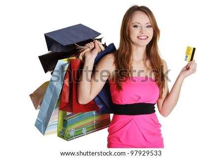Woman with shopping bags holding credit card, isolated on white background - stock photo