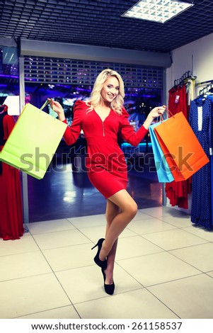 Woman with Shopping Bags in Shopping Mall. Shopper. Shopping Center. Sales. Clothes Shop - stock photo
