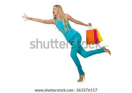 Woman with shopping bags isolated on white - stock photo