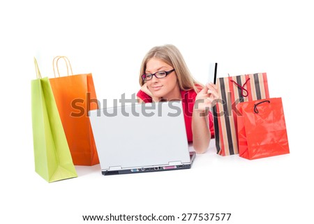 Woman with shopping bags shopping online, isolated on white - stock photo