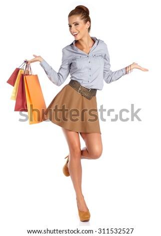 woman with shopping bags. Studio shoot - stock photo