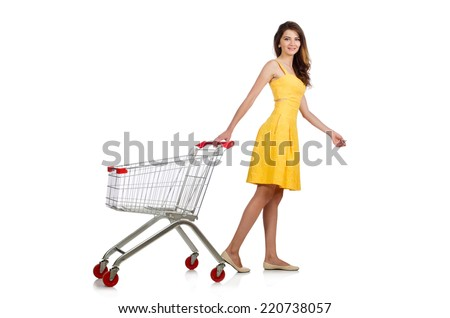 Woman with shopping trolley isolated on white - stock photo
