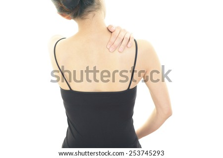 Woman with shoulder pain. - stock photo