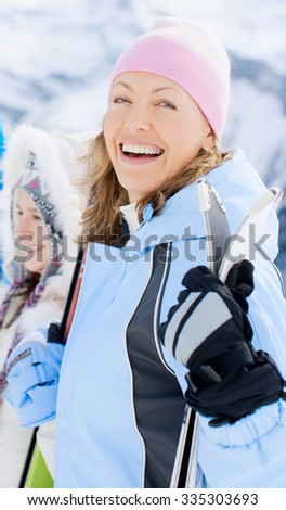 woman with ski at the mountains - stock photo