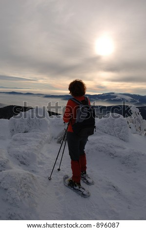 woman with snowshoes - stock photo