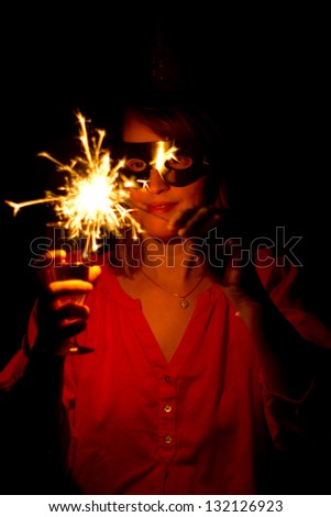 Woman with sparkler - stock photo