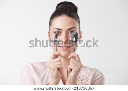 woman with spoon and fork - stock photo