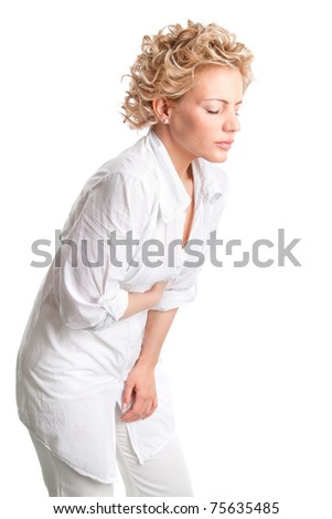 Woman with stomach issues isolated over white background - stock photo