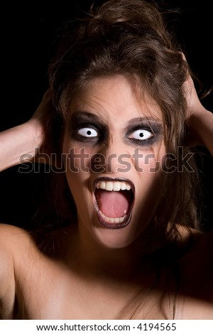 Woman with strange white eyes screaming her lungs out - stock photo