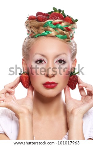 Woman with strawberry in her hairstyle over white background - stock photo