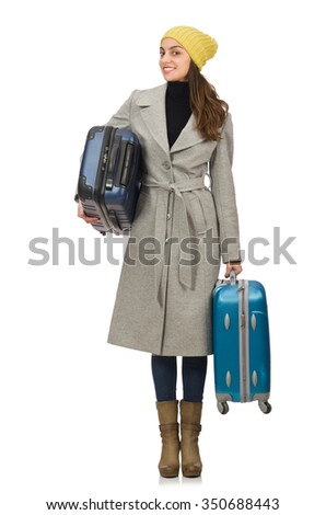 Woman with suitcase ready for winter vacation - stock photo