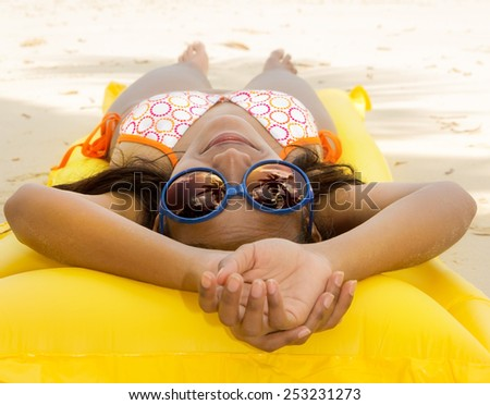 woman with sunglasses  resting on the beach - stock photo