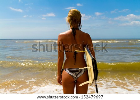 Woman with surf  - stock photo