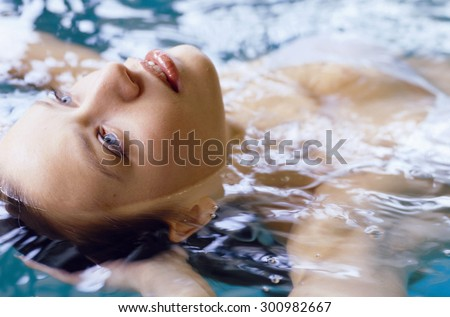 woman with swimsuit swimming on a water pool - stock photo
