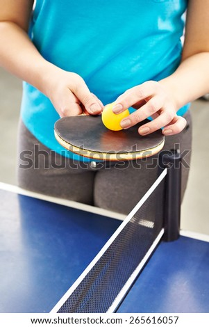 Woman with table tennis racquet closeup - stock photo