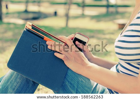 woman with tablet outdoors - stock photo