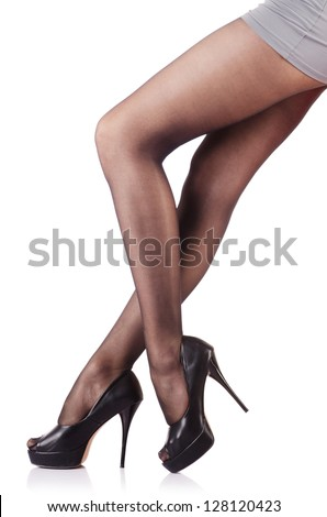 Woman with tall legs isolated on white - stock photo