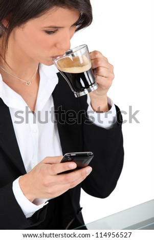 Woman with telephone and coffee - stock photo