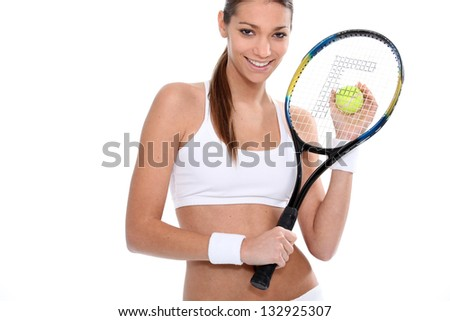 Woman with tennis racket and ball - stock photo