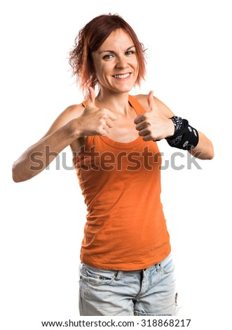 Woman with thumb up - stock photo