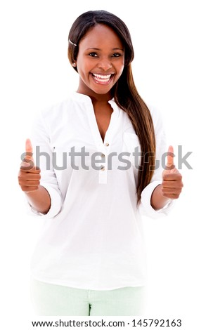 Woman with thumbs up smiling - isolated over a white background - stock photo