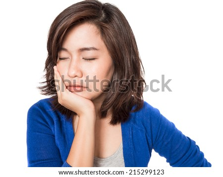 Woman with toothache holding her hand on her cheek - stock photo