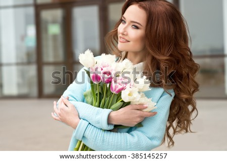Woman with tulips bouquet - stock photo