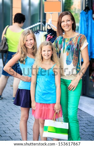 woman with two daughters shopping in an european city - stock photo