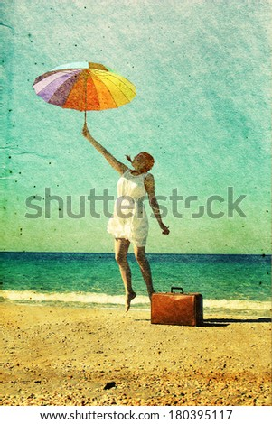 Woman with umbrella. Photo in old color image style. - stock photo