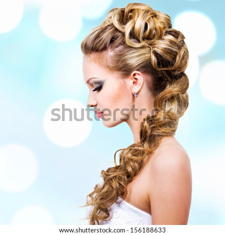 Woman with wedding hairstyle -  profile portrait - stock photo