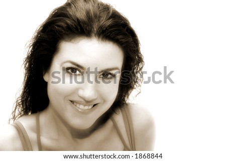 Woman with wet hair casual smile on sepia tone. - stock photo