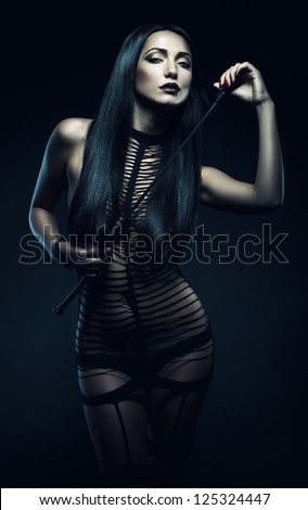 woman with whip - stock photo
