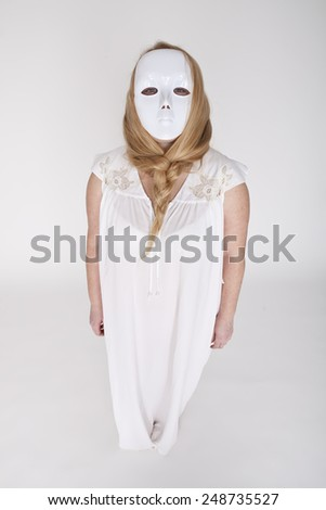 Woman With White Theatrical Mask. - stock photo