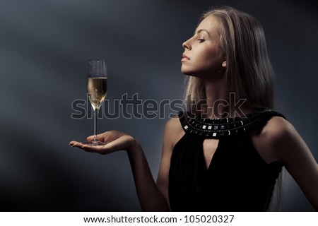 Woman with wine glass in hand - stock photo