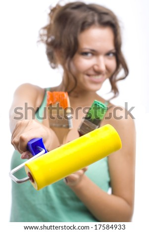 woman with yellow roll and brushes - stock photo