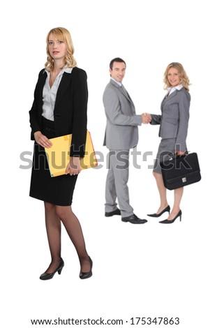 Woman witnessing hand-shake - stock photo