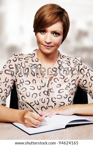 woman working at her desk - stock photo