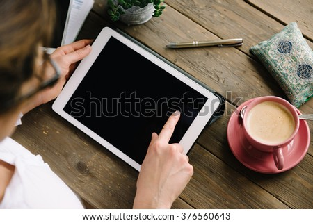 Woman working at home or surfing internet with digital tablet. Work home desk. - stock photo