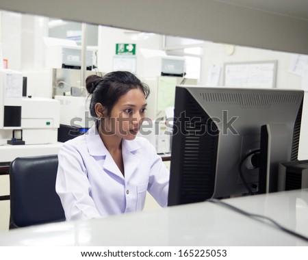 woman working in a laboratory - stock photo