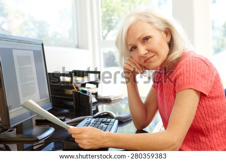 Woman working in home office - stock photo