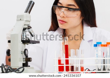woman working in laboratory - stock photo
